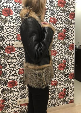 Куртка кожаная с мехом волка3 фото