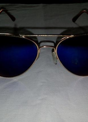 Очки синие с золотой оправой