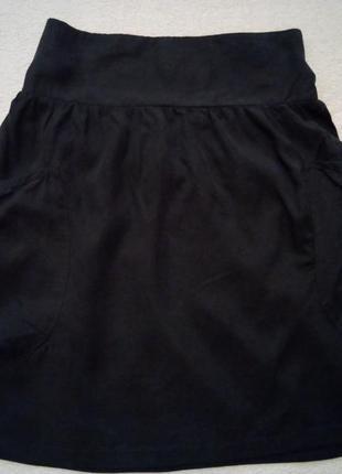 Серая юбка  с накладными карманами