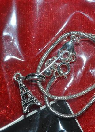 Новый серебристый браслет с шармом эйфелева башня avon в коробке
