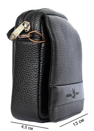Маленькая трендовая  мужская сумка. можно носить в руке, на плече и на ремне.