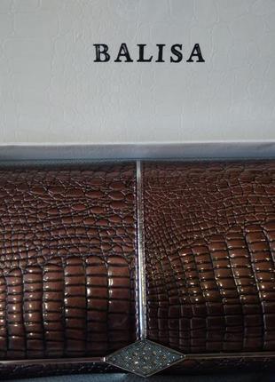 Кожаный женский кошелек под лаком коричневого цвета
