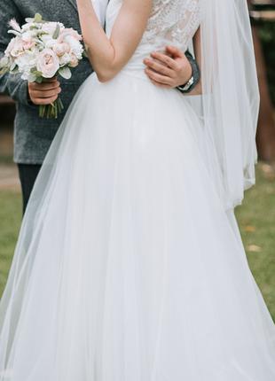 Нежное воздушное свадебное платье белого цвета5 фото