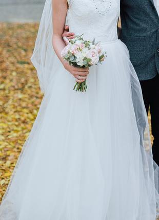 Нежное воздушное свадебное платье белого цвета3 фото