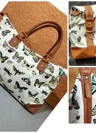 Фирменная стильная натуральная дорожная вместительная сумка.