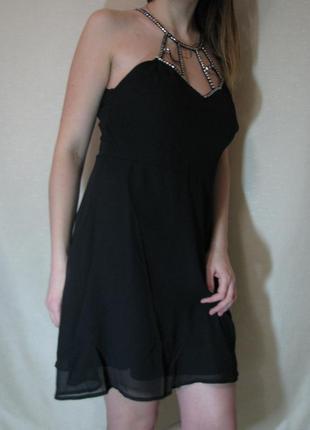 Платья черное выше колен