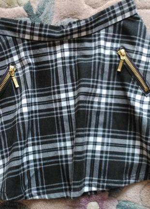 Трендова сіра юбка в клітку