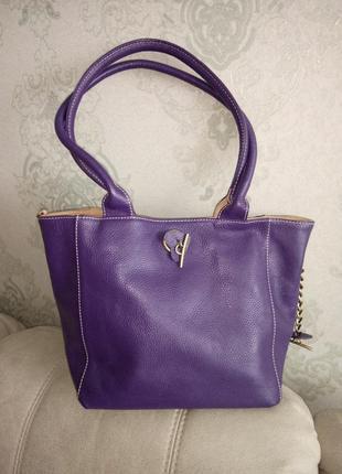 Красивая двухсторонняя кожаная сумка.