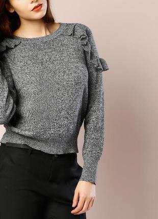 Меланжевый пуловер с воланами
