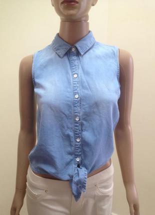 Джинсова сорочка без рукавів з вузликом спереді