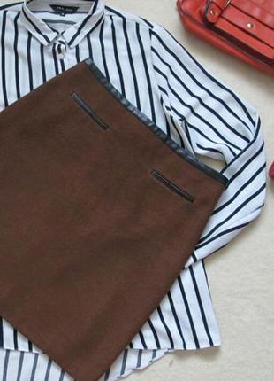 Трендовая мини-юбка с кожаными вставками в составе шерсть