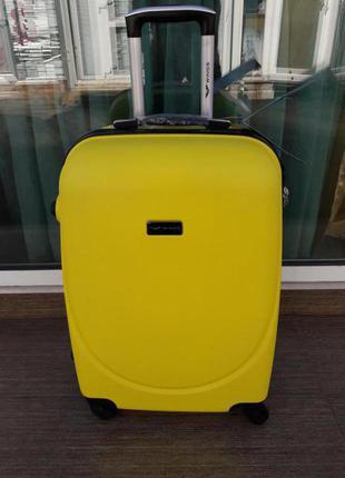 Оригинал! средний чемодан пластиковый желтый на 4-х колесах валіза середня жовта