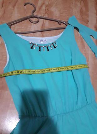 Берюзове плаття з поясом
