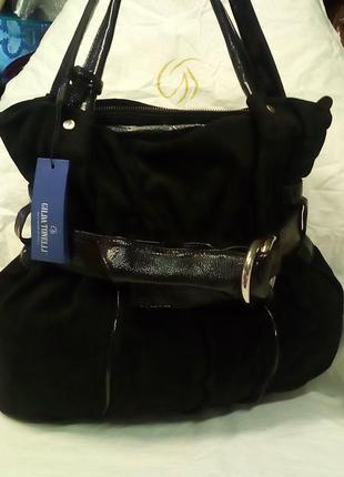 Стильная замшевая сумочка.бренд:gilda tonelli.