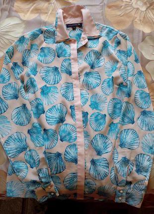 Бежевая блуза в ракушку