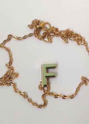 Ожерелье с кулоном буква f