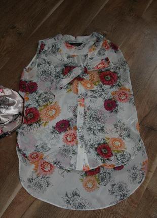 Блуза с удлиненной спинкой в цветочный принт