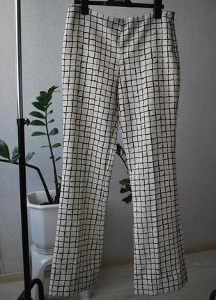 Трендовые брюки в клетку zara