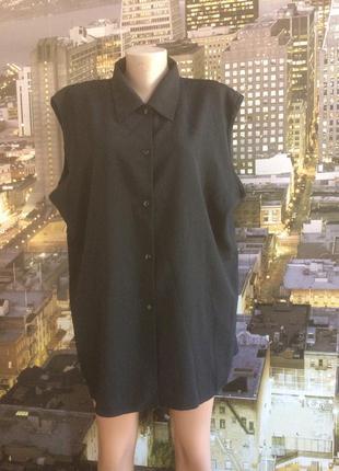 Насыщенная черная фактурная блуза