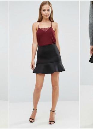 Стильная черная расклешенная юбка