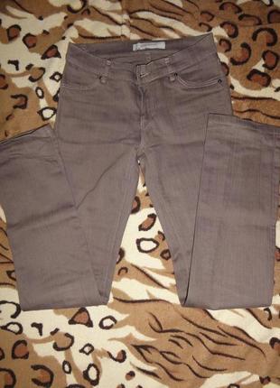Светло-коричневые джинсы штаны