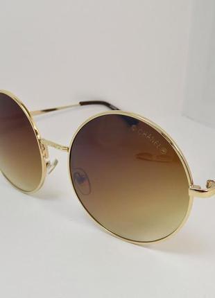 Круглые коричневые очки в золотой оправе