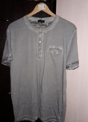 Фирменная футболка. р л/хл. польша. на ценнике 450 грн