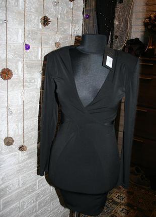 Платье обтягивающие новое с биркой указан рр12, но идет на с-м (42-44) 220грн