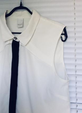 Стильная бело-чёрная блузка бренда villa clothes