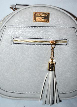 6302417e1347 Женский городской серый рюкзак из искусственной кожи с кисточкой 22*23 см