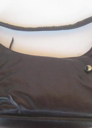 Кожаная сумка с плетенной ручкой