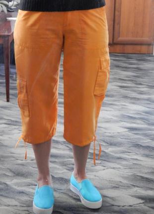 Оранжевые бриджи
