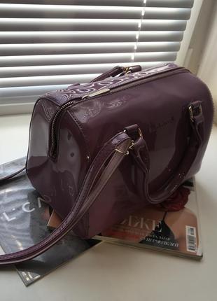 Фиолетовая лаковая сумка david jones