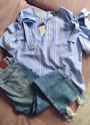 Блуза в полоску с бантами на рукавах