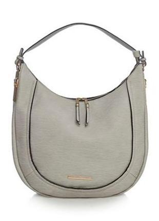 Зручна і стильна сумка заокругленої форми