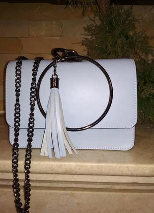 Красивая кожаная сумочка-клатч нежноголубого цвета. италия.