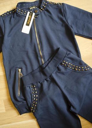 Фірмовий трикотажний спортивний костюм: кофта на замку та штани оригінального дизайну