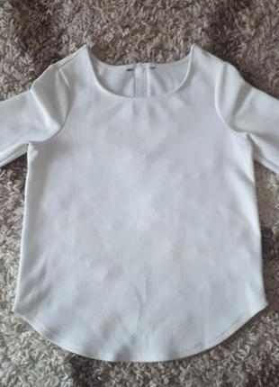 Стильная блуза из плотного фактурного трикотажа