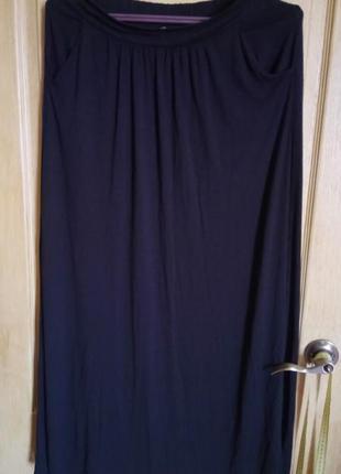 Длинная трикотажная юбка с карманами