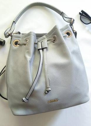 Стильная сумка сумочка бренд carpisa на коротких ручках
