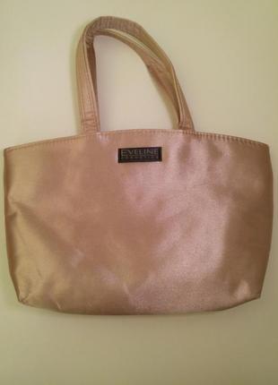 Золотистая сумка-косметичка от eveline
