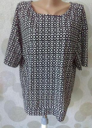 Стильная блуза с вырезом на спине