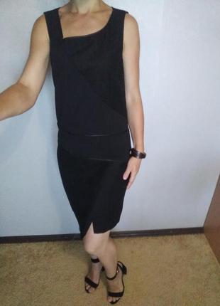 Стильное чёрное платье миди с асимметричным низом
