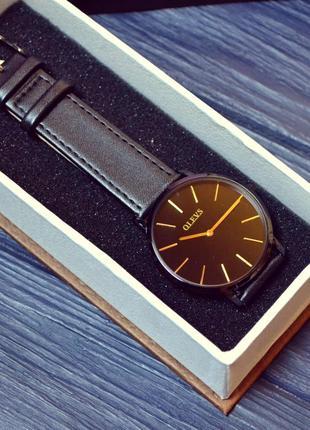 Olevs ультратонкие часы унисекс мужские женские  черные ремешок кожа в коробке новые