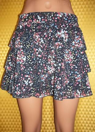 Женская шифоновая юбка воланами.