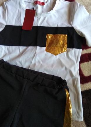Фирменый костюм с лампасами в золотые паетки..качество люкс. летний.  м