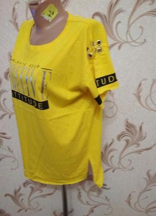 Футболка,блуза очень стильная с кольцами и надписью,яркая! очень стильная вещь !