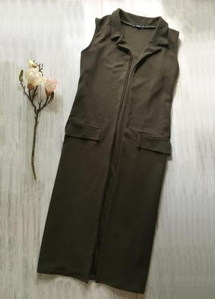 Актуальная жилетка безрукавка миди цвета хаки