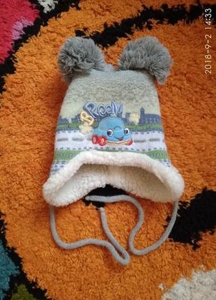 Зимняя шапка с тремя бунбонами