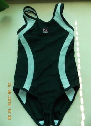 Фирменный спортивный купальник next р-р116.можно для плавания и для гимнастики.